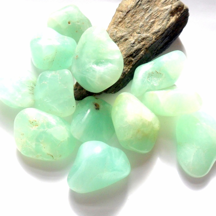 gem stone stock mineral prehnite vvoennyy gemstone tumbled isolated depositphotos photo