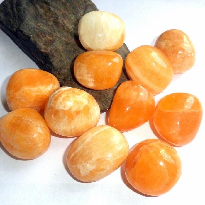orange calcite polished gemstone